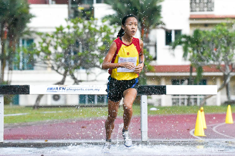 Clarice Lau of HCI stopped the clock at 8:04.28 to secure a convincing victory in the A Division girls' 2000m Steeplechase final. (Photo 1 © Iman Hashim/Red Sports)