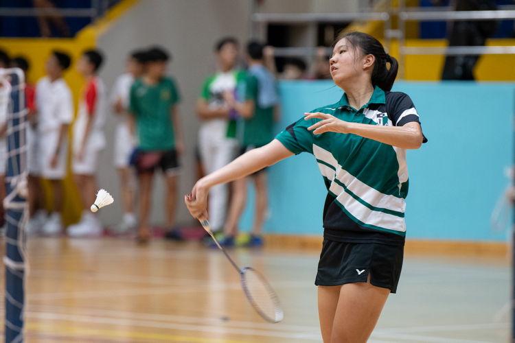 Joanna Wu Chu Jia of Raffles Girls swings a forehand high serve.