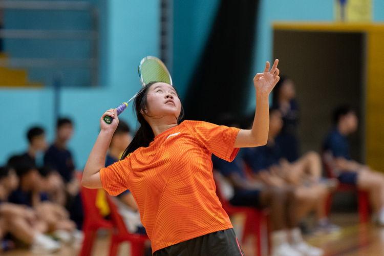 Lee Chin Mun prepares to return a high serve.