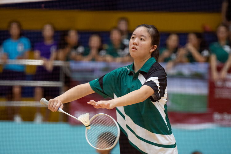 Clarice Hannah Beh Shi Li of Raffles Girls with a backhand low serve.