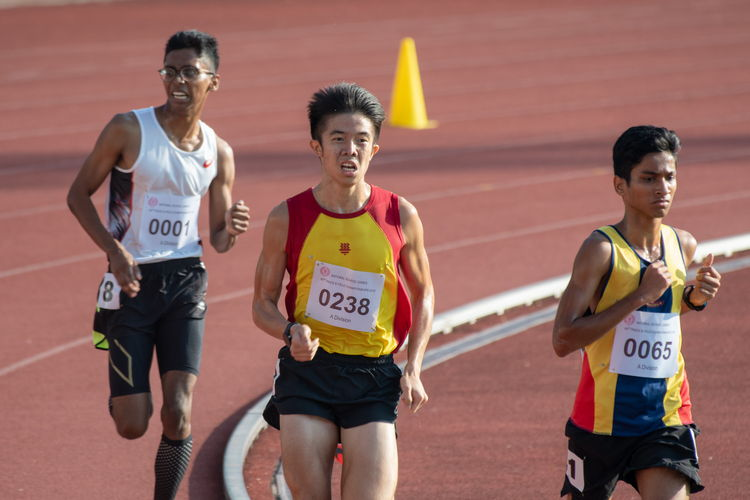 Ethan Yikai Yan (middle), who placed first in the 5000m A Division Boys' Finals, and Ruben S/O Loganathan (on the left), who placed second with a massive, full, 400-meter lap lead on Rajesh Muthu S/O Ramanathan (right), who placed tenth.