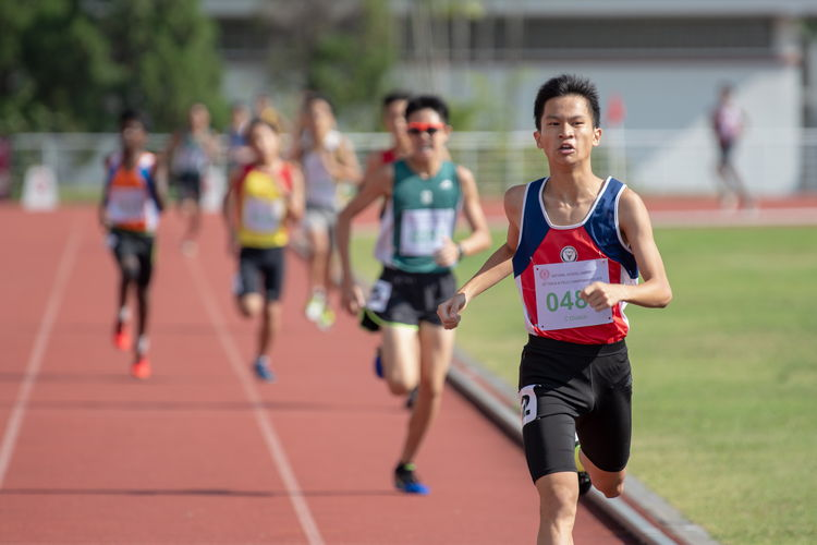 Mervyn Ong Shao Xuan of NHHS (in red and blue) placed first in the 1500m C Division Boys' Finals.