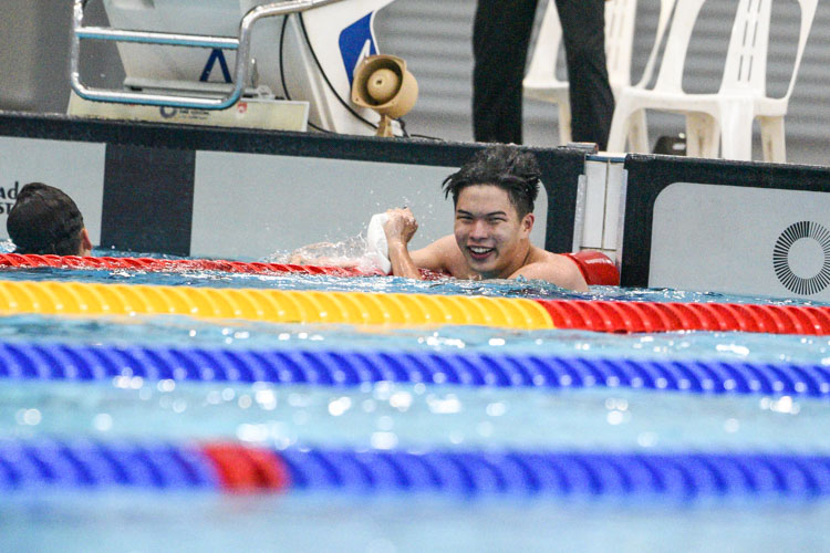 Nicholas Cheong of ACS(I) celebrates after winning the A Division boys' 100m Breaststroke final with a time of 1:05.42. (Photo 1 © Iman Hashim/Red Sports)