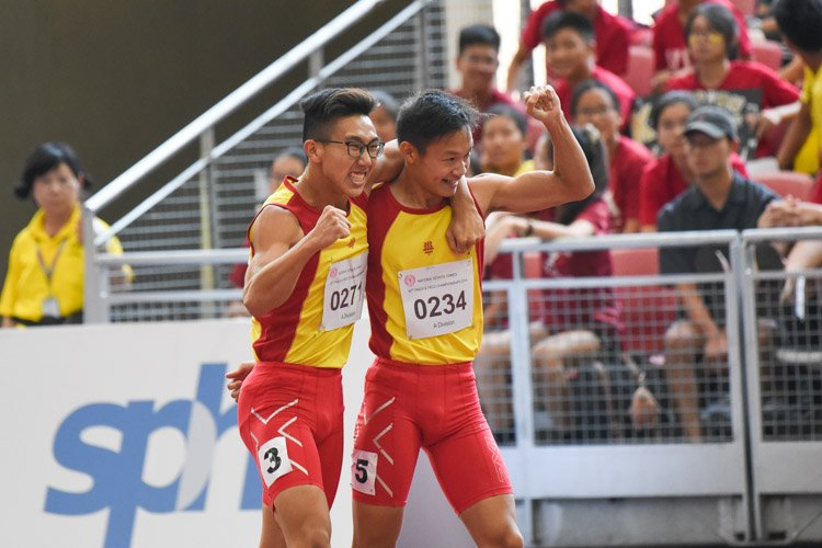 Tedd Toh (#271) of Hwa Chong Institution celebrating with teammate Bryan Lam (#234) after the A Division boys' 100m final. The pair finished in first and second place respectively. (Photo X © Iman Hashim/Red Sports)
