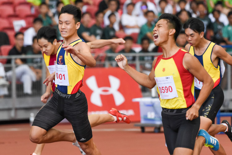 Zeen Chia (#590) of HCI celebrates upon crossing the finish line first in the B Division boys' 100m final. (Photo 1 © Iman Hashim/Red Sports)
