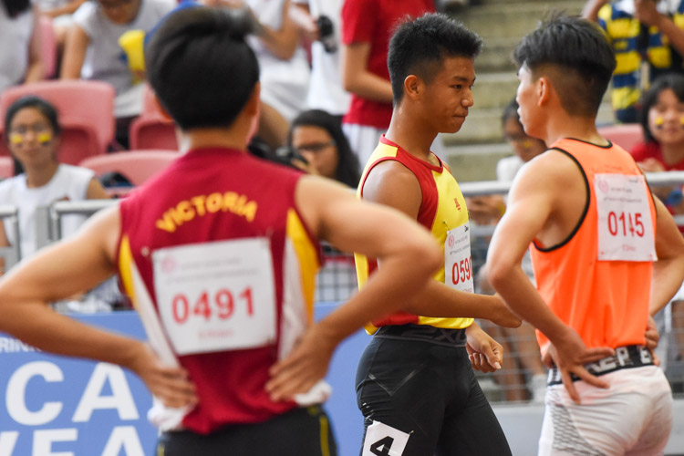 HCI's Zeen Chia (middle) reacts after his seeing his name flash first on the big screen showing the results of the race. (Photo 1 © Iman Hashim/Red Sports)