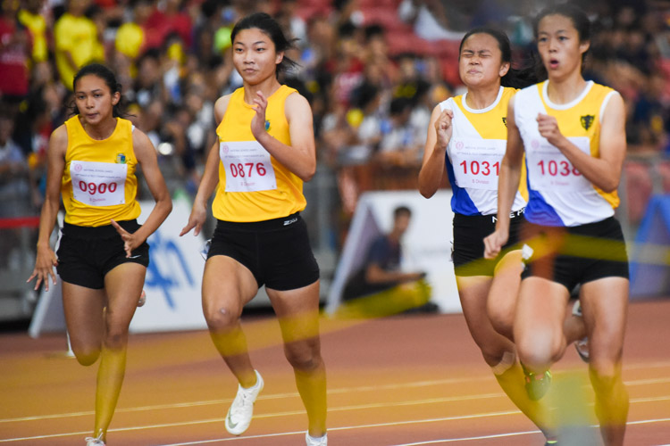 Choo Hui Xin (#876) of Cedar Girls' and Jade Chew (#1031) of NYGH placed fourth and fifth with timings of 12.77s and 12.78s respectively. The top six in the B Division girls' 100m final all finished in under 13 seconds. (Photo X © Iman Hashim/Red Sports)
