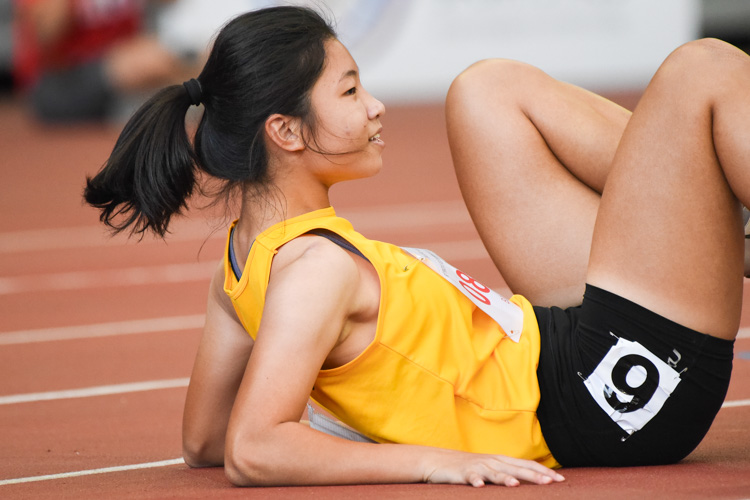 Choo Hui Xin of Cedar Girls' Secondary falls onto the track after throwing herself over the finish line in the B Division girls' 100m final. She placed fourth with a time of 12.77s. (Photo 1 © Iman Hashim/Red Sports)