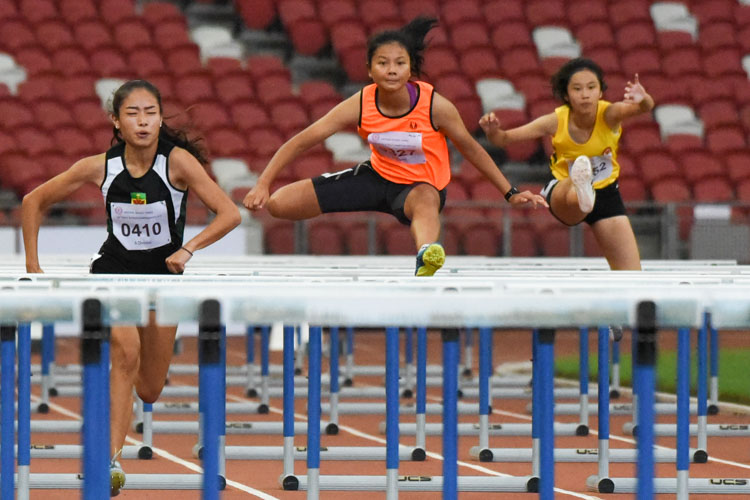 Palada Tang (#327) of Singapore Sports School clears a hurdle on her way to claiming silver in the A Division girls' 100m hurdles final with a time of 16.33s. (Photo X © Iman Hashim/Red Sports)