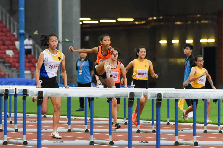 Tyeisha Khoo of Singapore Sports School clears a hurdle. She finished with the silver in the B Division girls' 100m hurdles final with a time of 15.80s. (Photo X © Iman Hashim/Red Sports)