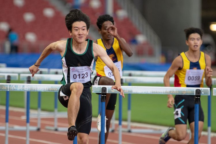 Matz Chan (#123) of RI speeds to victory in the A Division Boys' 110m hurdles final. He finished in first place with a time of 00:15.70.