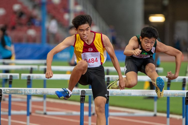Gabriel Lee (#484) of Victoria School coming in first place in the B Division Boys' 110m hurdles final.