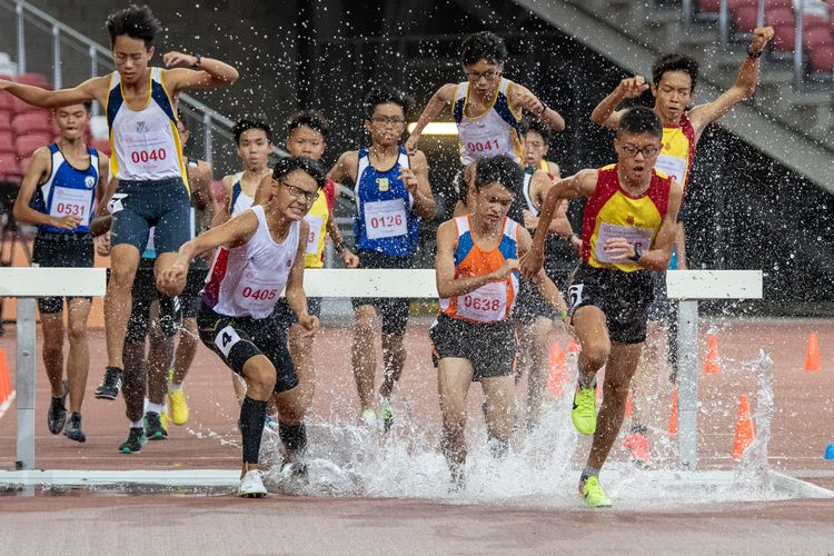 Loh Wei Long (#638) of Yuan Ching Secondary School won the B Division Boys' 2000m steeplechase final with a time of 06:54.53.
