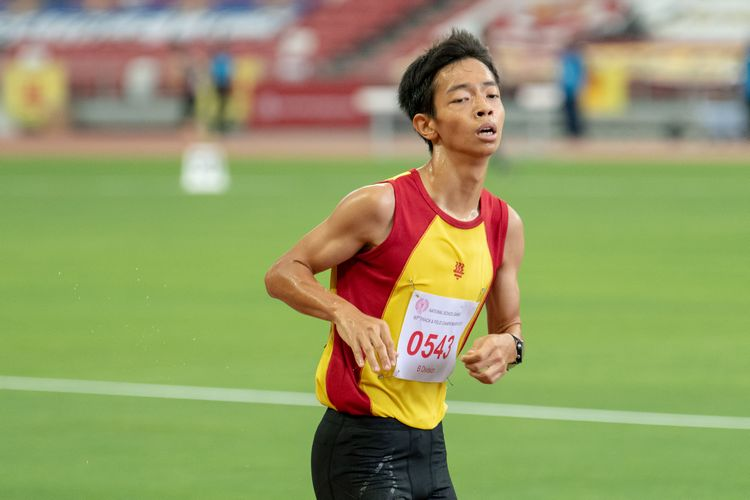 Aeron Young Liren (#543) crossed the finish line in second position in the B Division Boys' 2000m steeplechase final with a time of 06:58.49.