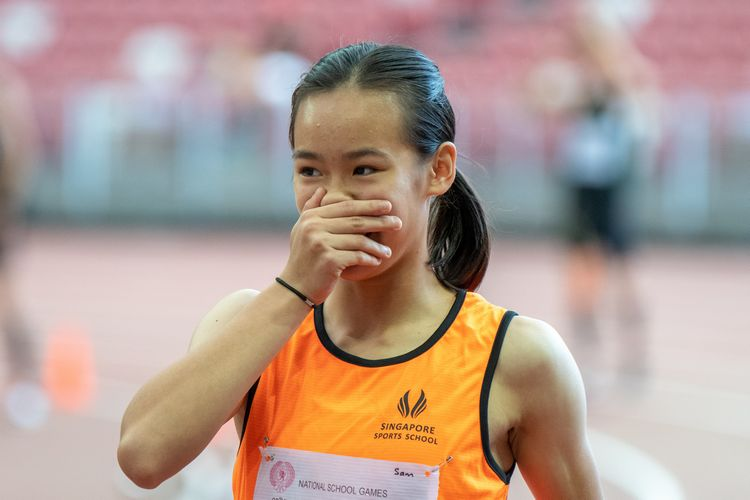 Samantha Theresa Ortega (#609) of Singapore Sports School realizes she won the C Division Girls' 100m final.
