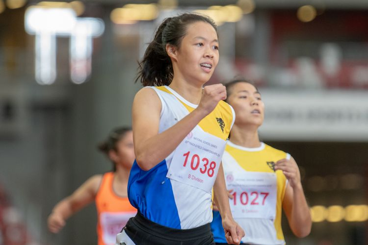 Elizabeth-Ann Tan (#1038) of NYGH finished in first place in the B Division Girls' 100m final with a record-breaking time of 00:12.25.