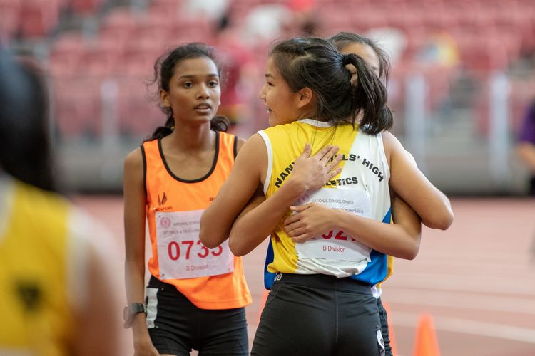 Bernice Liew (#1027) of NYGH embraces a fellow NYGH runner after the B Division Girls' 100m final. Bernice finished in second place with a time of 00:12.43.