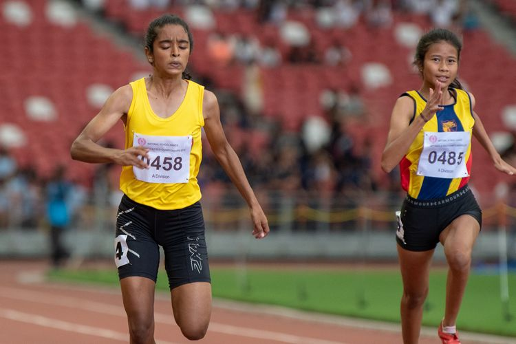 First and second A Division Girls' 100m final runner-ups Kathya Kodikara (#458) of VJC and Nurul Insyirah (#485) of ACJC.