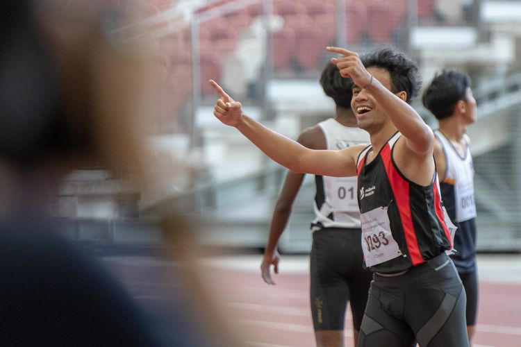 Ibrahim B Hajil (#293) of MI celebrates after his third place finish in the A Division Boys' 100m final.