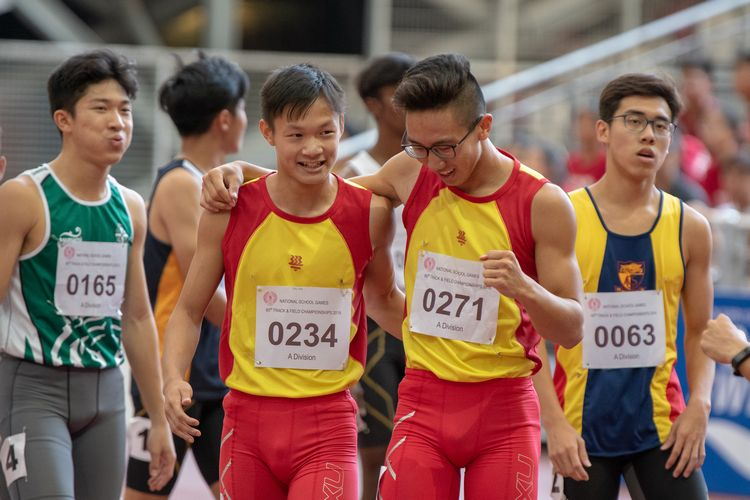 1-2 winners Tedd Toh (#271) and Bryan Lam (#234), both of HCI, walk off the track together after the A Division Boys' 100m final.