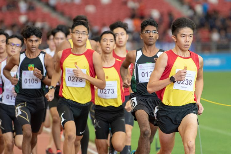Ethan Yan (#238) leads the pack in the A Division Boys' 1500m final. He went on to finish third with a time of 04:10.45.