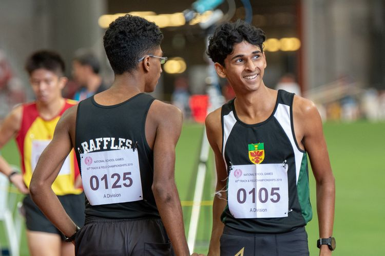 Nedunchezian Selvageethan (#125) and Armand Dhilawala Mohan (#105), both of RI, share a brief moment on the track after finishing the A Division Boys' 1500m final in first and second place respectively.