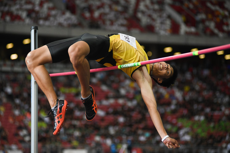 Kampton Kam of VJC smiling as he cleared the 2.15-metre height. He came in first in the A Division Boys' High Jump event and broke the schools national record and the under-20 record with a final height of 2.15 metres. (Photo 1 © Stefanus Ian/Red Sports)