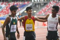 (Right to left) Ruben S/O Loganathan of Anderson Serangoon Junior College, Joshua Rajendran of Hwa Chong Institution and Armand Dhilawala Mohan of Raffles Institution coming together for a photo after the A Division Boys' 3000 metres steeplechase race. (Photo 1 © Stefanus Ian/Red Sports)