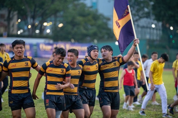 ACS(I) players celebrate their victory over the Saints in the B Div Rugby final.