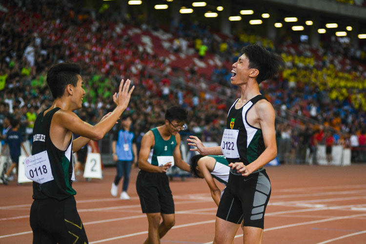 Marcus Tan (#122) of Raffles Institution screaming with joy after clinching the gold medal for his team in the A Division Boys' 4x400m relay race. (Photo 1 © Stefanus Ian/Red Sports)