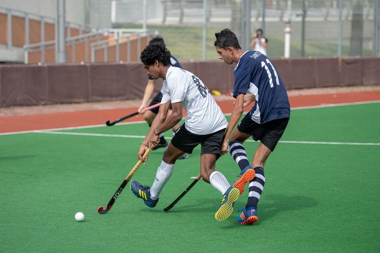 Saints player Puneeth Khetan (#17) attempts to wrest control of the ball from Raffles forward Bairaj Singh (#88).