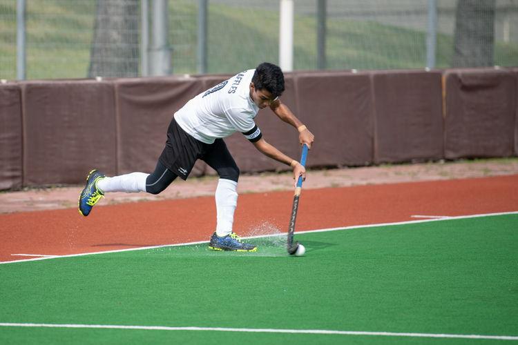 Raffles captain Raziq Noor (#9) takes a short corner.