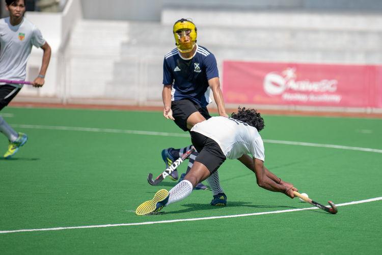 Raffles' Akash Chandra (#82) scoring the second goal of the game.