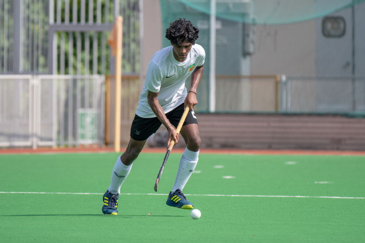 Akash Chandra (#82) of RI pauses briefly to control the ball.