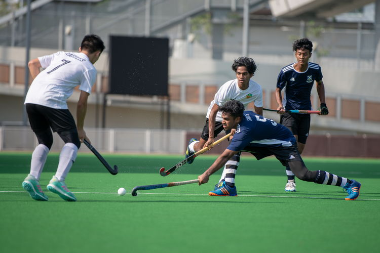 Sailesh Kumar (#5) of SAJC gets between two Raffles players.