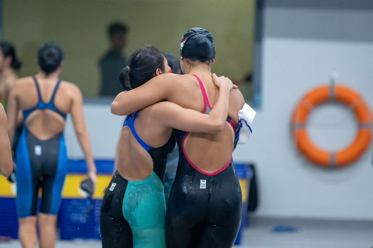"""On the right, Sarah Yip of RGS, who would've won the B DIvision Girls' 200m butterfly final if she had not been disqualified for """"starting before the starting signal."""""""