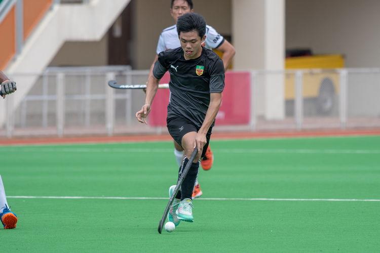 Ethan Tan (#7) of RI dribbles the ball towards the ASRJC goal.