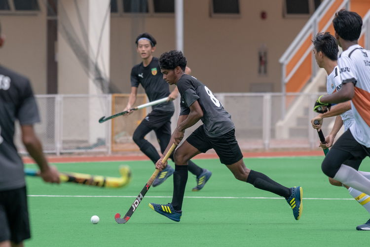 Akash Chandra (#88), Raffles' playmaker, dribbles the ball across the field.