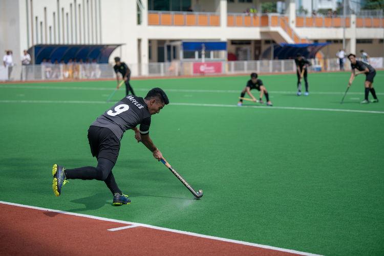 Raffles captain Raziq Noor (#9) makes a pass in a Raffles short corner.