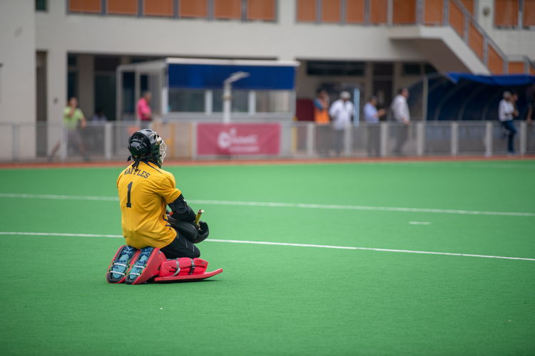 Raffles keeper Alexander Kong (#1) rests while his team keeps the ball in the ASRJC half.