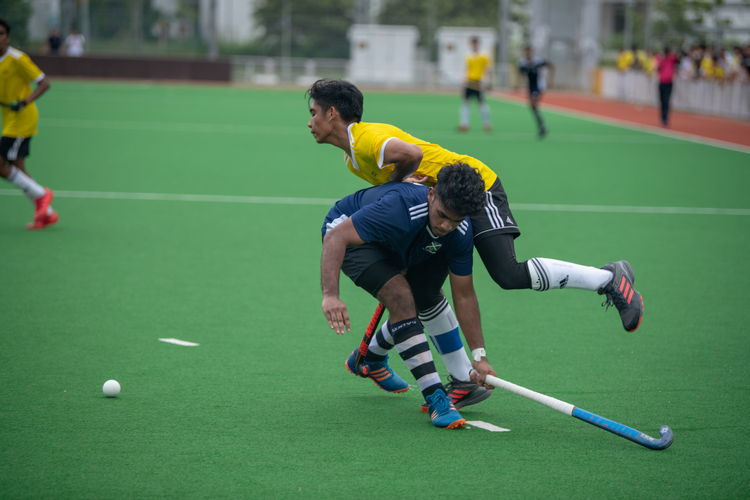 Sailesh Kumar (Saints #5) collides with a VJC forward.
