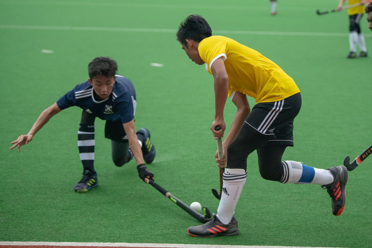 Ryu Tanaka (Saints #7) inserts his stick into the path of the ball, narrowly stopping a VJC attack.