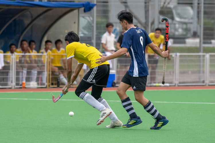 Ray Au (#9) of SAJC raises his hands in exasperation after losing the ball to a VJC player.