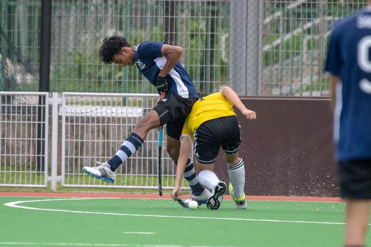 James Rodrigues (VJC #4) steals the ball from Saints player Adam Ahmad B Shamsul Nahar (#19).