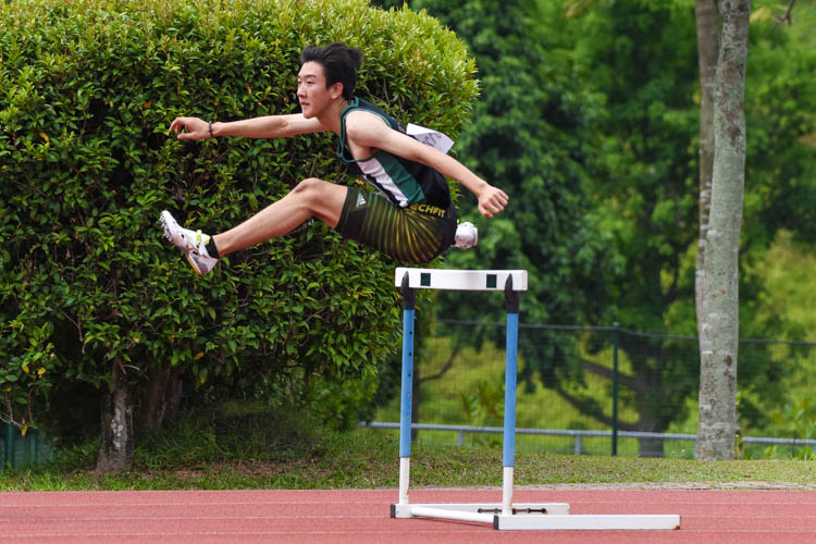 Matz Chan of RI clears his first hurdle in the A Division boys' 400m hurdles final. He finished first in 57.25 seconds. (Photo 1 © Iman Hashim/Red Sports)