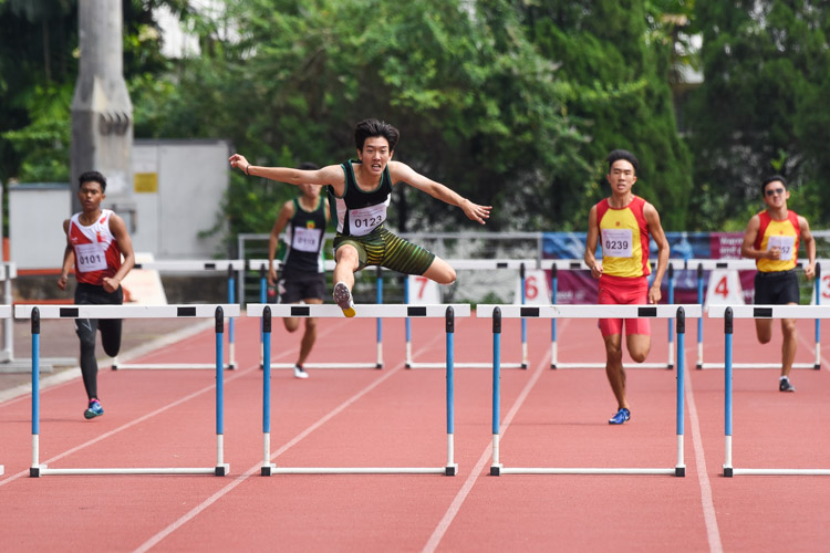 Matz Chan (#123) of RI clears his final hurdle in the A Division boys' 400m hurdles final. He finished first in 57.25 seconds. (Photo 1 © Iman Hashim/Red Sports)