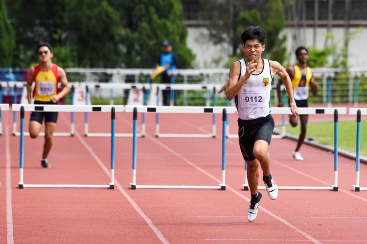Jered Wong (#112) of RI races to the finish line. He finished second in the A Division boys' 400m hurdles final with a time of 57.79s. (Photo 1 © Iman Hashim/Red Sports)