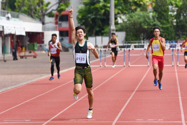 Matz Chan (#123) of RI celebrating as he crossed the finish line in the A Division boys' 400m hurdles final. He finished first in 57.25 seconds. (Photo 1 © Iman Hashim/Red Sports)