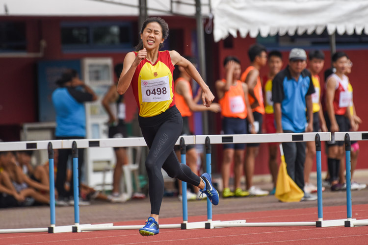 Amanda Ashley Woo of Hwa Chong Institution stopped the clock first in the A Division girls' 400m hurdles final with a time of 1:05.96. It is her third gold in four years for the event. (Photo 1 © Iman Hashim/Red Sports)