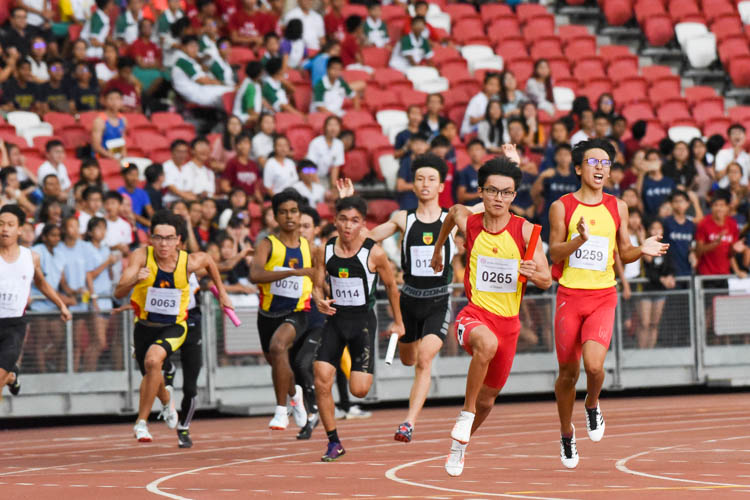 RI's Joshua Timothy D'cruz (#114) eyes HCI's Sin Ming Wei after receiving the baton in the A Division boys' 4x100m relay. HCI and RI finished in first and second respectively. (Photo 1 © Iman Hashim/Red Sports)